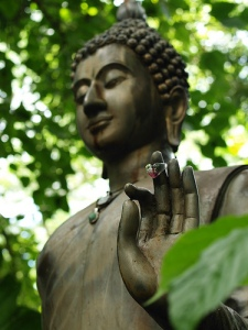 buddha statue with hand up