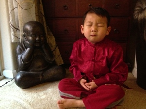 young boy meditating